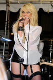 Taylor Momsen leggy in black garters perfoms during the Teen Vogue Fashion's Night Out Fashion Show -